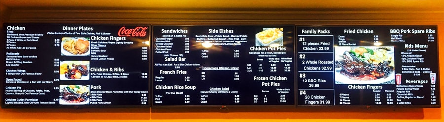 A digital menu board in a fried chicken restaurant.